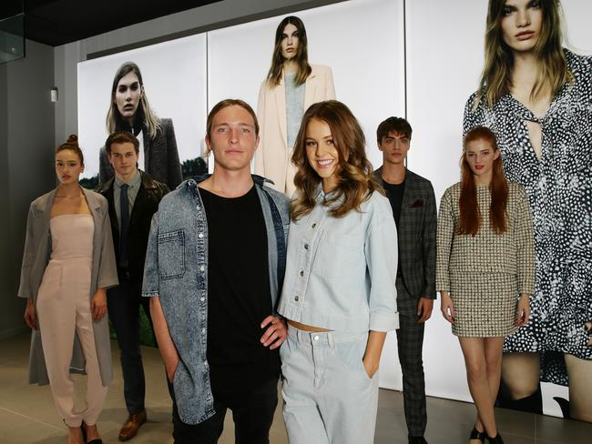 Topshop's new store at the Emporium. L to R. Surfer Sean Keenan and Actor Isabelle Cornish with Topshop models in the background. Picture:Andrew Tauber