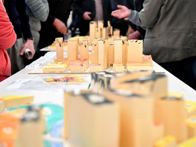 Residents in Sydney's south west view 3D models of a potential high-rise development on display at a community meeting by the Sydenham to Bankstown Alliance. Picture: AAP Image/Joel Carrett