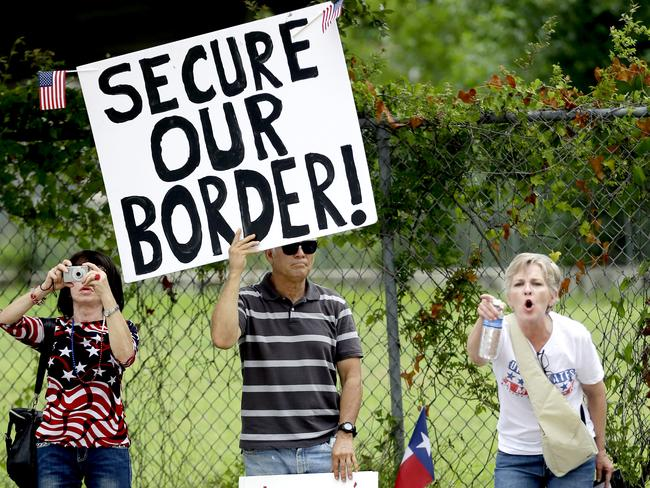 Angry demonstrators ... hold signs and yell outside the Mexican Consulate in Houston, Texas. Picture: David J. Phillip