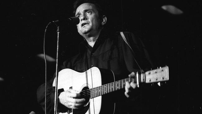 In which year did US country music singer/songwriter/guitarist Johnny Cash die?