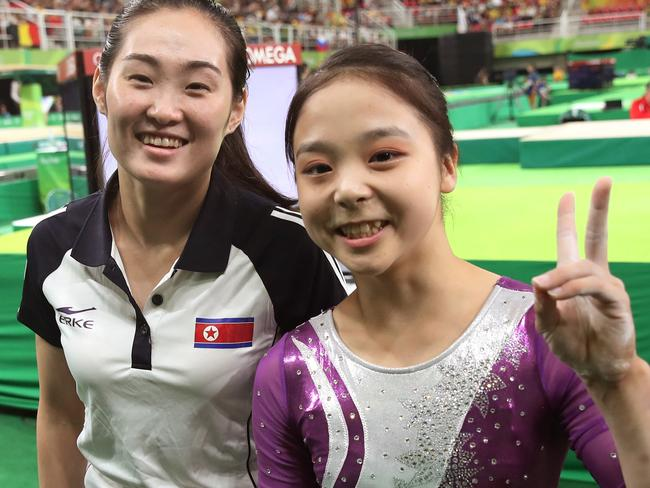 Bridging the divide, South Korean gymnast Lee Eun-ju, right, and her North Korean counterpart Hong Un Jong pose together during the artistic gymnastics women's qualification. Picture: Kim Do-hoon/Yonhap