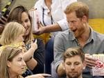 Prince Harry (R) sits with David Henson's wife Hayley Henson (L) and daugther Emily Henson at the Sitting Volleyball Finals during the Invictus Games 2017 at Mattamy Athletic Centre on September 27, 2017 in Toronto, Canada. Picture: Getty Images
