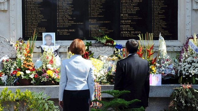 Australian Prime Minister Julia Gillard stands with Bali Governor Made Mangku Pastika as they pay respects to the 2002 Bali bombings victims at the Bali Memorial Monument in Kuta, Bali. Picture: Sony Tumbelaka