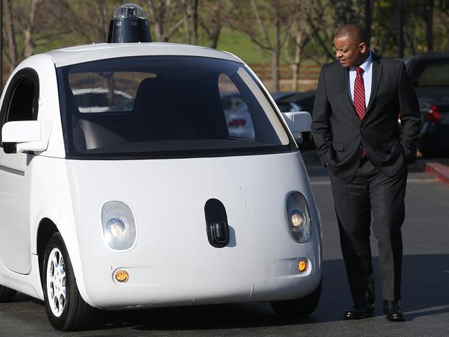 US Transportation Secretary Anthony Foxx inspects a Google self-driving car in California. Picture: Justin Sullivan/Getty Images/AFP