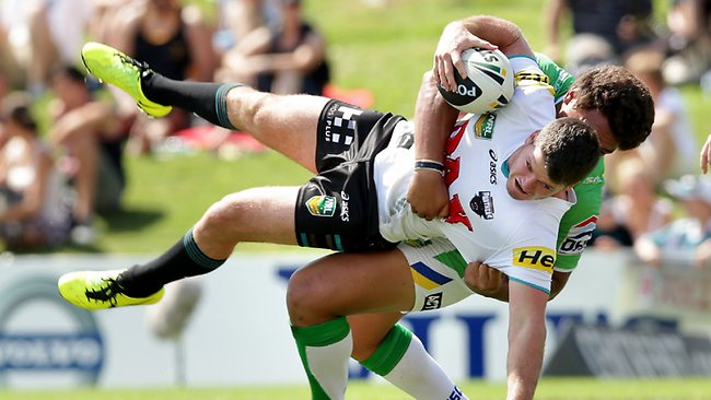 Lachlan Coote tackled by Josh Papalii. Picture: Gregg Porteous