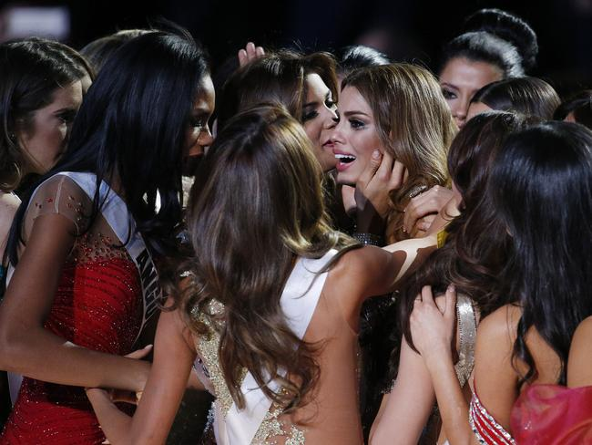 Other contestants comfort Miss Colombia ... Ariadna Gutierrez after she was incorrectly crowned Miss Universe. Picture: AP