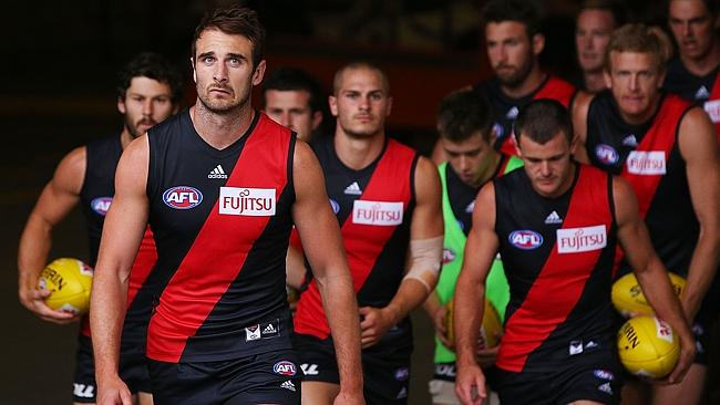 Bombers captain Jobe Watson leads his team out ahead of the NAB Challenge match against P
