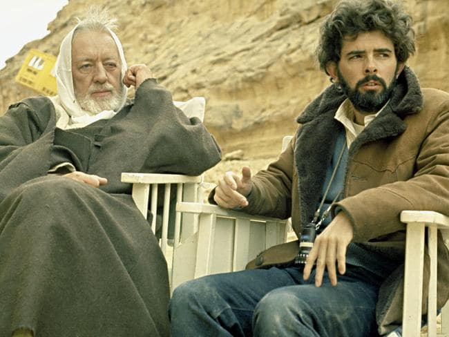 Director George Lucas with Alec Guinness on the set of the first Star Wars film in 1976.