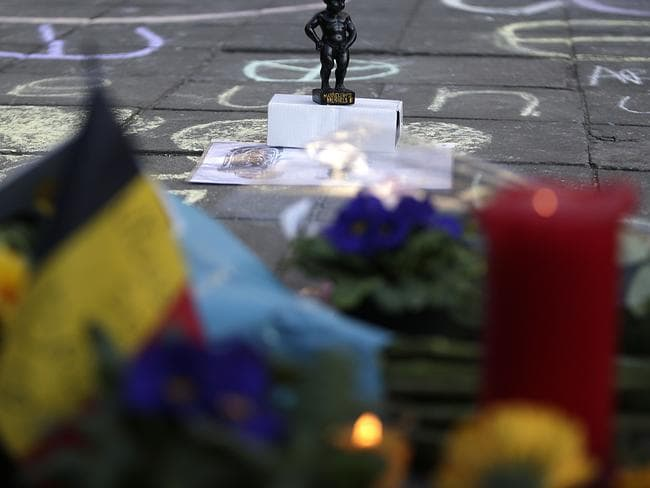 Flowers at a makeshift memorial at Place de la Bourse in Brussels. Picture: Kenzo Tribouillard/AFP