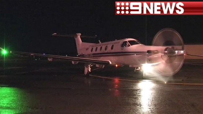 Four fishermen who were rescued after being swept from a cliff face near Shark Bay arrived back in Perth last night, transported by the Royal Flying Doctor Service. Picture: Nine News