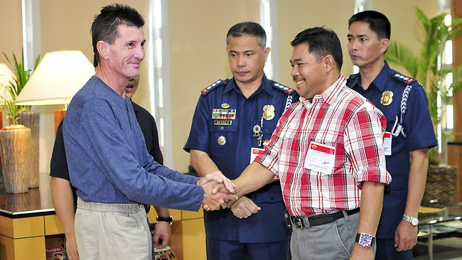 Australian national Warren Rodwell is greeted by Philippine National Police officials and Basilan Vice-Governor Al Rashid Sakalahul before he delivers a short statement to the media at Manila International Airport on March 25, 2013 in Manila, Philippines. (Photo by Veejay Villafranca/Getty Images)