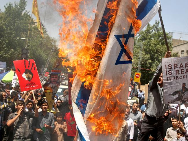 Terrorist claims ... Iranians burn a representation of an Israeli flag as they chant slogans during an annual pro-Palestinian rally in Tehran, Iran.