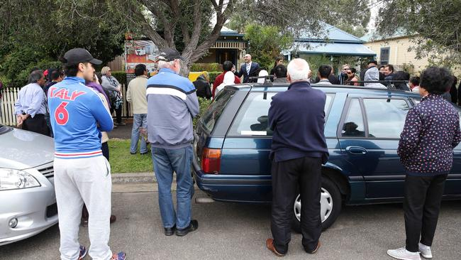 There was a large crowd at the auction of 17 Kemp St, Granville and most were first-home buyers. Picture: Carly Earl