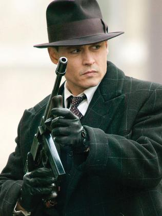 Johnny Depp as John Dillinger.