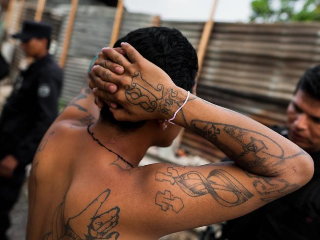 The Barrio 18 gang members are detained by the police officers. Picture: Jan Sochor.