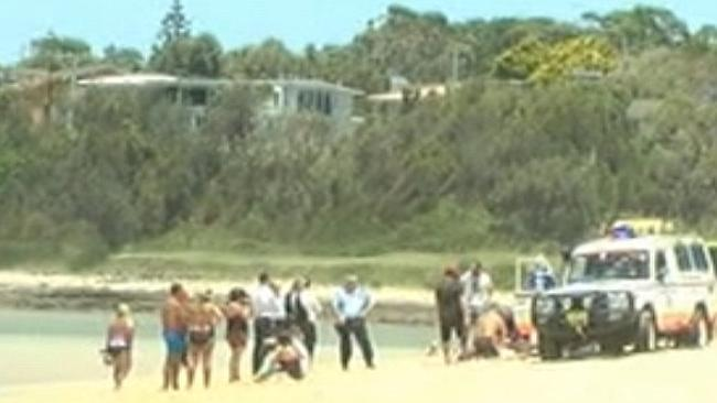 Channel Nine screengrab of the scene shortly after Mr Priestly was pulled from the water.