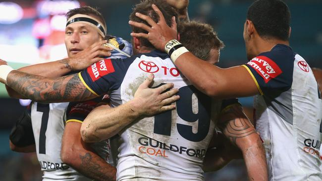 The Cowboys celebrate a try against the Rabbitohs. Pic: Mark Kolbe/Getty Images