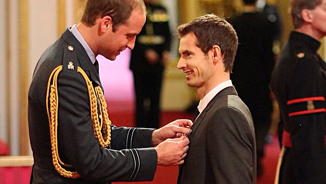 Wimbledon champion Andy Murray, right, receives his Order of the British Empire (OBE) medal from the from Prince William.