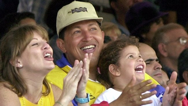 Venezuela's President Hugo Chavez and his wife Marisabel with their daughter Rosa Ines watch a parade on Children's Day in Caracas, Venezuela in 2001. Picture: Ivan Gonzalez/AP