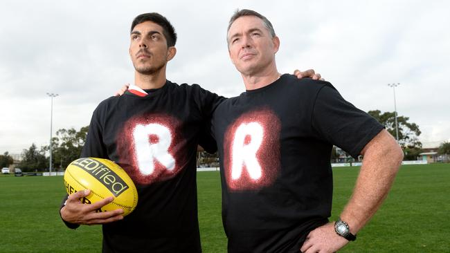 Richardson and Saints player Terry Milera show their support for the AFL indigenous round.
