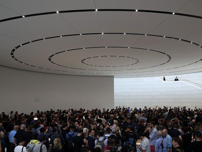 Attendees look at new Apple products during an Apple special event at the Steve Jobs Theatre. Picture: Getty/AFP