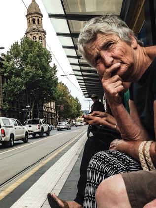 A file picture of a man waiting for a tram in the city ... the wait for the airport to CBD tram will likely be about 20 years. Picture: Roy VanDerVegt
