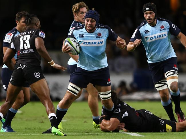 Dean Mumm has his progress halted by the Sharks defence.
