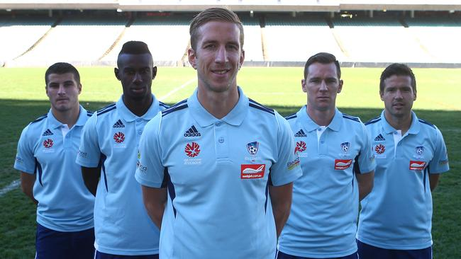 SYDNEY, AUSTRALIA - JULY 31: Marquee signing Marc Janko poses for a photo with his team mates during a Sydney FC A-League press conference at Allianz Stadium on July 31, 2014 in Sydney, Australia. (Photo by Renee McKay/Getty Images)