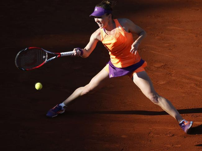 Romania's Simona Halep returns the ball to Germany's Andrea Petkovic during their French Open semi-final.