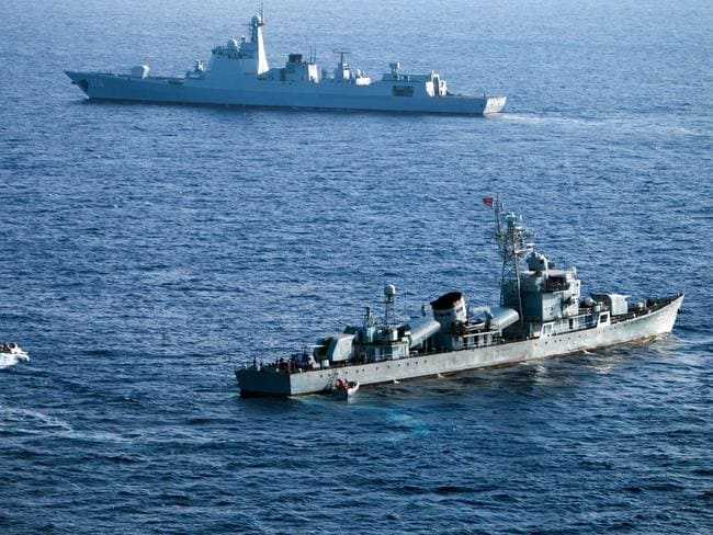 China's South Sea Fleet taking part in a drill. Naval, coastguard and fishing vessels are currently active around a sandbar in the Spratly Islands. Picture: AFP