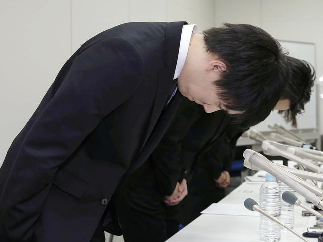 Coincheck President Koichiro Wada, foreground, bows in apology after the company lost $660 million. Picture: Kyodo News via AP