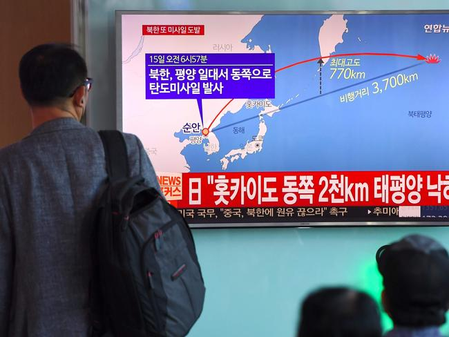 A man watches a screen showing a graphic of a North Korean missile launch, at a railway station in Seoul. North Korea has fired several intermediate range ballistic missile eastwards over Japan. Picture: AFP / JUNG Yeon-Je