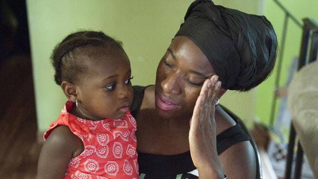 Tragic loss ... Decontee Sawyer, the wife of Liberian government official Patrick Sawyer, is overcome with grief