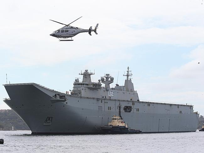 Australia's biggest warship 'Nuship Canberra', a Helicopter Landing Dock, arrives at its new home at Garden Island. Picture: Mark Evans