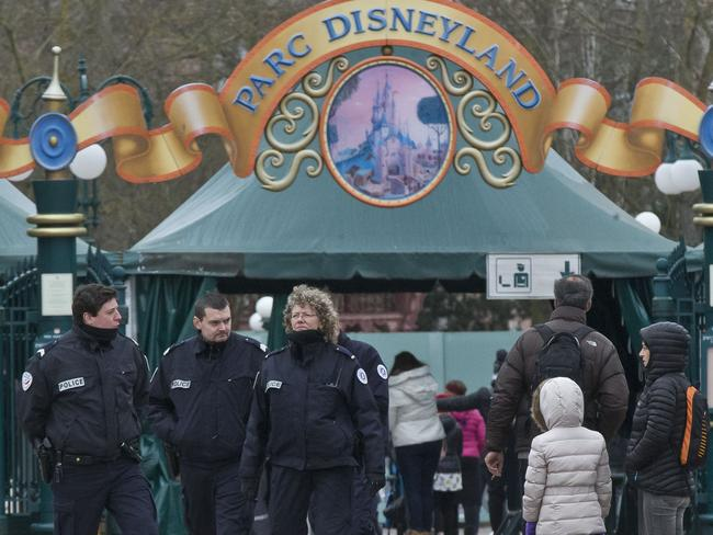 Thwarted ... French police officers patrol outside Disneyland Paris. Police arrested a man who had entered the theme park with guns and ammunition. Picture: AP/Michel Euler