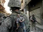 A US Marine of the 1st Division carries a mascot for good luck in his backpack as his unit pushed further into the western part of Fallujah, Iraq. Picture: Anja Niedringhaus/AP
