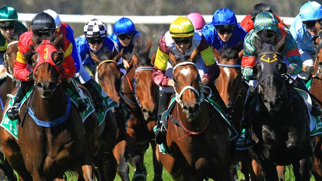 Loving home ridden by Tye Angland (yellow cap, maroon with yellow armbands) wins race 1 during Scone Races located in the Upper Hunter Region of NSW. The Bend. Pic Jenny Evans