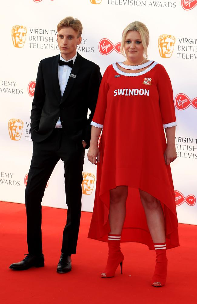 Sibling comedy duo Charlie and Daisy May Cooper, who repped Swindon Town F.C. merchandise — with an interesting red carpet twist. Picture: Fred Duval/MEGA
