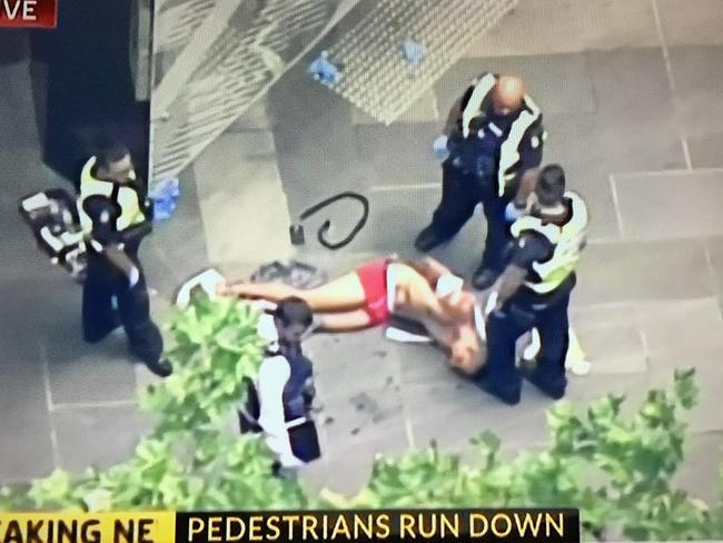 The man being taken into custody.