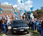 <p>Funeral for Jai, Tyler and Bailey Farquharson. School kids from Winchelsea Primary School form a guard of honour as the first of the two hearses leaves the church. They released blue and white balloons. Picture: Jon Hargest</p>