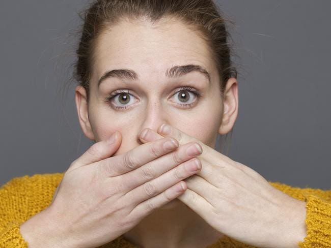 girl covering her mouth for regret or mistake, hand over mouth, generic