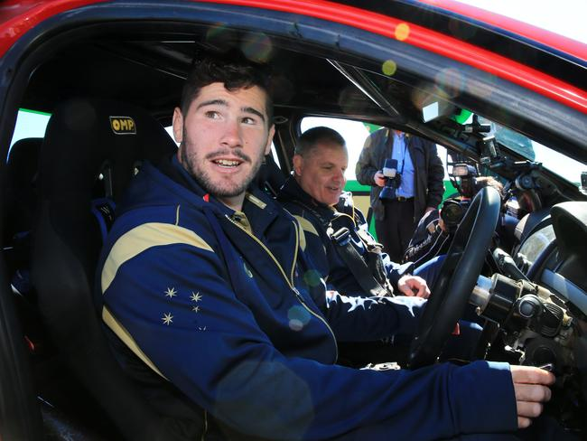 Nathan Charles and Ewen McKenzie try out Russell Ingall's V8 Commodore on Mount Panorama.