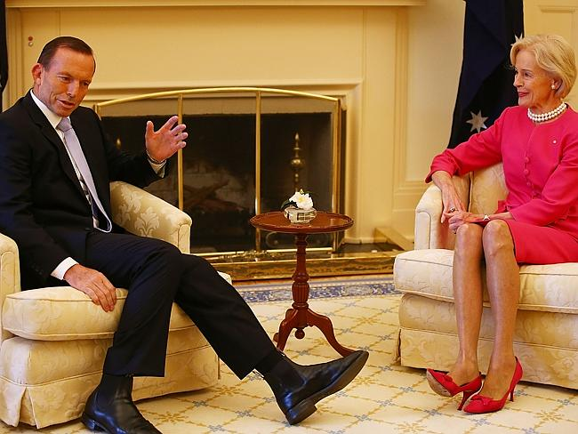 "Goes with ""our best wishes"" ... Prime Minister Tony Abbott talks with the Australia's first female Governor-General Quentin Bryce at Government House."