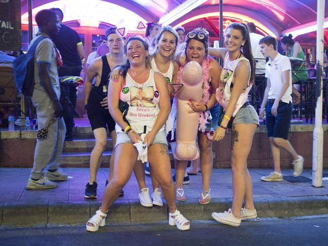 Young British tourists pose with an inflatable penis in Magaluf.