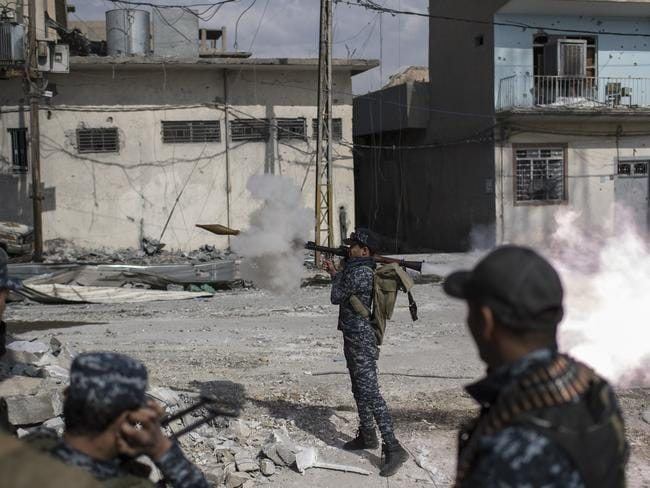 A Federal Policeman fires an RPG towards Islamic State positions in the old city during fighting on the western side of Mosul on April 1. Picture: AP