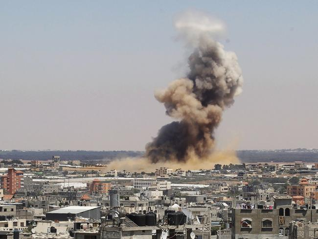 Deadly strikes ... smoke and dust rise following an Israeli air strike in Rafah, in the south of the Gaza Strip.