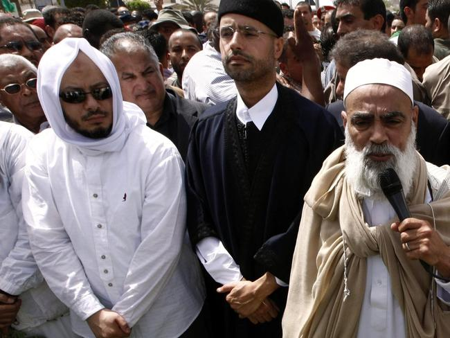 Mohammed (L) and Saif al-Islam Gaddafi (2nd L), sons of embattled Libyan leader Muammar Gaddafi in 2011. Picture: AFP.