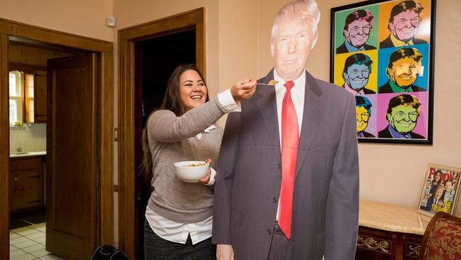NY Post reporter Gabrielle Fonrouge and cardboard Trump share a spot of breakfast. Picture: Annie Wermeil/NY Post