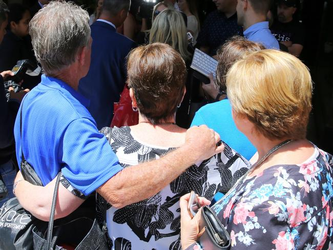 Family and friends of the victims of paedophile Timothy James Stewart outside court on Wednesday. Picture: John Grainger.