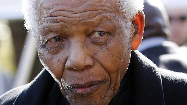 """(FILES) A picture taken on June 17, 2010 shows former South African President Nelson Mandela in Sandton. Nelson Mandela is still in hospital for """"extra-ordinary"""" care and there is no crisis over his health, days after he underwent surgery to remove gallstones, President Jacob Zuma said on December 18, 2012. Zuma said doctors are """"satisfied that the progress he is making is consistent with his age."""" AFP PHOTO / POOL - Siphiwe Sibeko"""